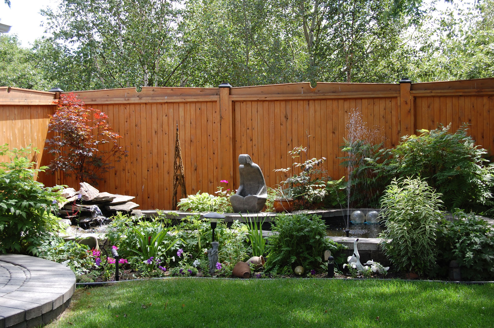 Backyard garden with professional landscaping service.