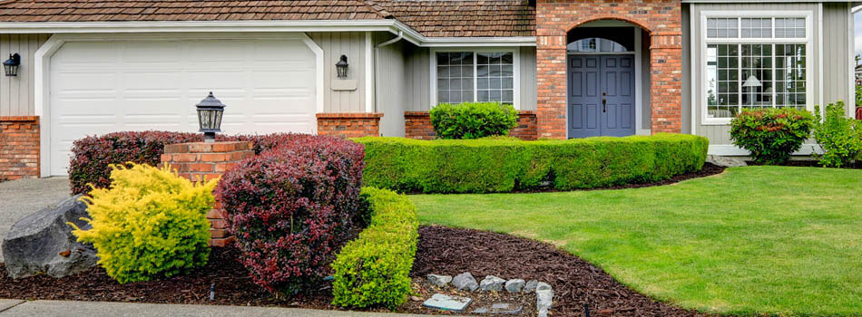 Home with trimmed shrubs and hedges in Sudbury, ON.